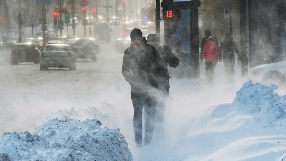 Pedestrians battle the blowing snow and wind chills in the -30C range, Friday, January 5, 2018 in Montreal. (THE CANADIAN PRESS/Ryan Remiorz)