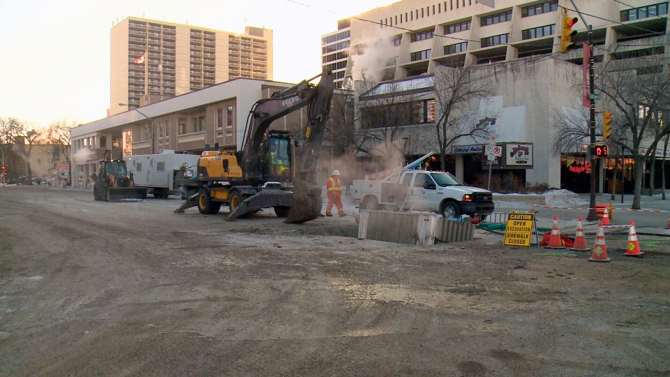 Saskatoon city crews work Friday, Jan. 12, 2018, to repair a water main after a break left the nearby Frances Morrison library without heat and water.