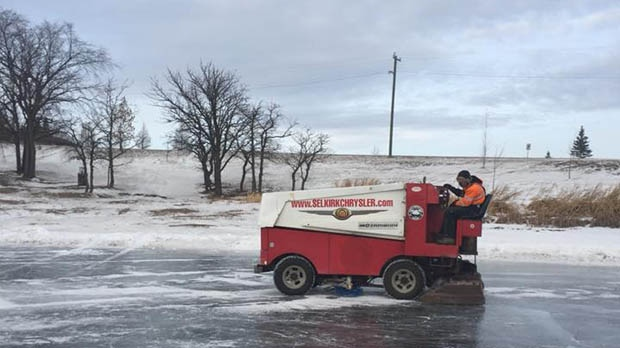 Dave Penner maintaining the ice (Source: Henry Wiebe/Morden Lake Skating Trail Facebook group)