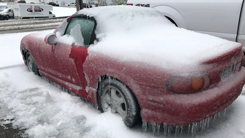 Shad Rashidi's Mazda Miata was covered in an inch-thick blanket of ice when he returned to the parking lot where he'd left it overnight. (Nafeesa Karim / CTV Vancouver)