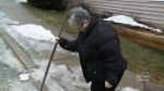 Linda Negus prepares for the 100 millimetres of rain that could arrive in Saint John over the weekend.
