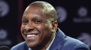 Toronto Raptors president Masai Ujiri smiles as he take parts in a news conference in Toronto on Friday, July 7, 2017. THE CANADIAN PRESS/Frank Gunn