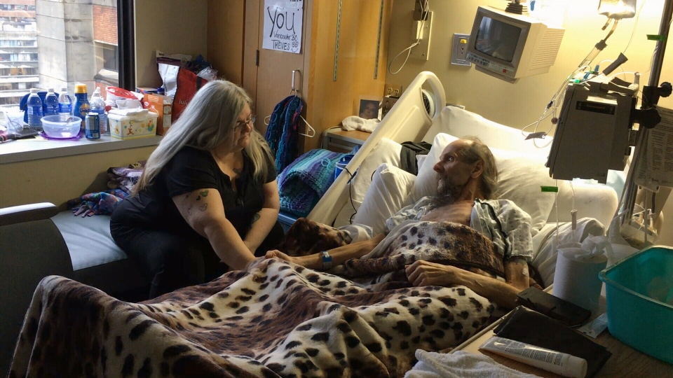 Jean Jones, left, visits her brother Alan Johnson, right, in hospital.