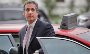 Michael Cohen, U.S. President Donald Trump's personal attorney, steps out of a cab during his arrival on Capitol Hill in Washington, Tuesday, Sept. 19, 2017. (AP Photo/Pablo Martinez Monsivais)