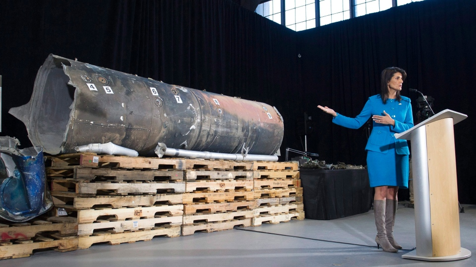 U.S. Ambassador to the UN Nikki Haley gestures as she speaks in front recovered segments of an Iranian rocket during a press briefing at Joint Base Anacostia-Bolling, Thursday, Dec. 14, 2017, in Washington. (AP Photo/Cliff Owen)