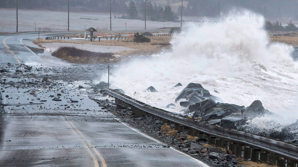 Waves pound the shore on a closed section of Highway 207 in Lawrencetown, N.S. on Friday, Jan. 5, 2018. THE CANADIAN PRESS/Andrew Vaughan