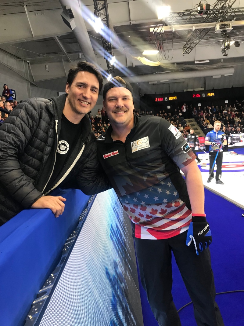 U.S. curler Matt Hamilton has his picture taken with Prime Minister Justin Trudeau at the Continental Cup in London on Friday, Jan. 12, 2018.  (Twitter / @heccabamilton)