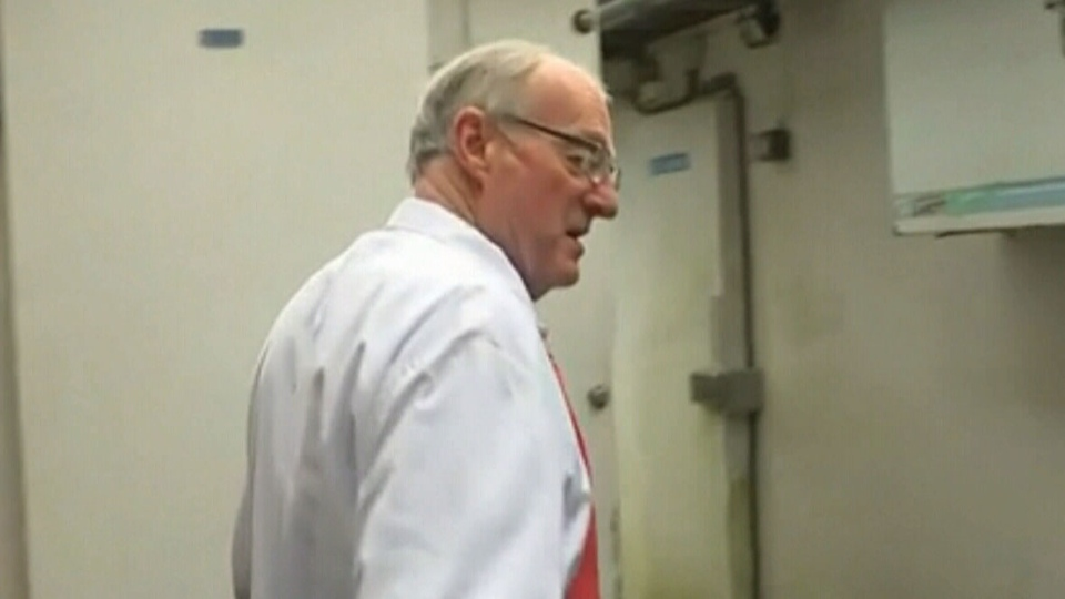 Chris McCabe says he became trapped in the walk-in freezer at his shop in Totnes, southwest England.