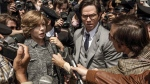 "FILE - This image released by Sony Pictures shows Michelle Williams, left, and Mark Wahlberg in TriStar Pictures' ""All The Money in the World."" (Fabio Lovino/Sony-TriStar Pictures via AP)"