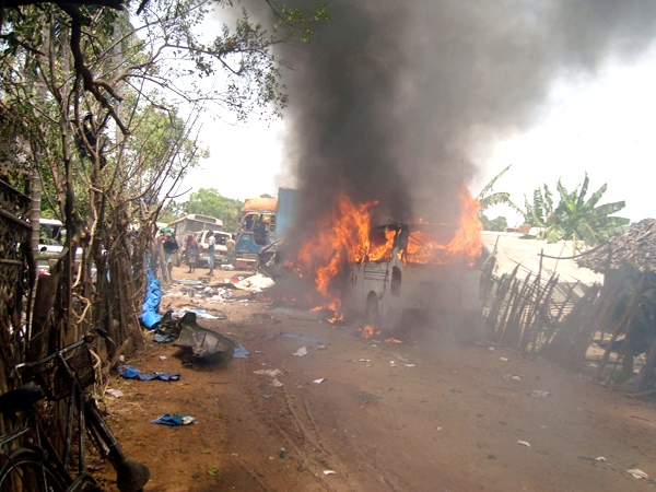An ambulance is seen burning outside a makeshift hospital in Mullivaikal, Sri Lanka, Wednesday, May 13, 2009. (AP Photo)