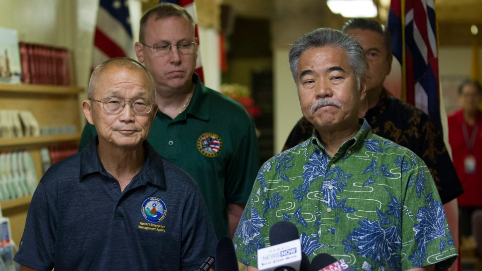Vern Miyagi, Administrator, HEMA, left, and Hawaii Gov. David Ige addressed the media Saturday, Jan. 13, 2018. (George F. Lee /The Star-Advertiser via AP)