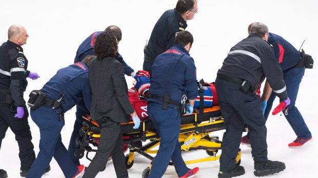 Montreal Canadiens' Phillip Danault on stretcher