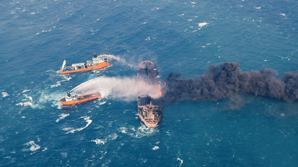 In this Wednesday, Jan. 10, 2018, photo provided by China's Ministry of Transport, firefighting boats work to put on a blaze on the oil tanker Sanchi in the East China Sea off the eastern coast of China. (Ministry of Transport via AP)