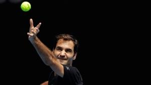 Switzerland's Roger Federer serves during a practice session ahead of the Australian Open tennis championships in Melbourne, Australia, Sunday, Jan. 14, 2018. (AP Photo/Dita Alangkara)