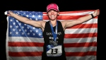 Becca Pizzi holds an American flag after winning the seventh and final leg of the World Marathon Challenge -- seven marathons in seven days on seven continents -- in Sydney, Australia. (AP Photo/Rob Griffith, 2016 file)