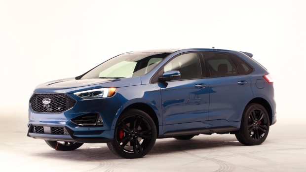 Carmakers roll out brawny pickups, futuristic SUVs at Detroit auto show