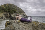 William Whelan is shown in this undated handout image at Beach Cove in Portugal Cove, N.L. near St. John's for the 2018 Merb'ys calendar. A calendar of bearded, mermaid-tailed Newfoundlanders has raised hundreds of thousands of dollars for mental health. (THE CANADIAN PRESS)