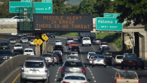 "In this Saturday, Jan. 13, 2018 photo provided by Civil Beat, cars drive past a highway sign that says ""MISSILE ALERT ERROR THERE IS NO THREAT"" on the H-1 Freeway in Honolulu. (Anthony Quintano/Civil Beat via AP)"
