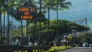 "This photo provided by Jhune Liwanag shows a highway median sign broadcasting a message of ""There is no threat"" in Kaneohe, Hawaii, Saturday, Jan. 13, 2018.  (Jhune Liwanag / AP)"