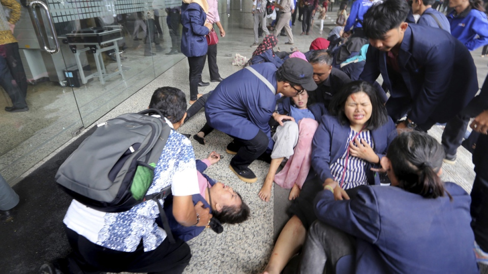 Injured persons are evacuated from the Jakarta Stock Exchange tower in Jakarta, Indonesia, on Jan. 15, 2018. (AP)