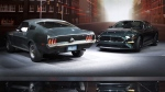 Ford introduces the 2019 Mustang Bullitt, right, next to one of the original cars used in the iconic movie 'Bullitt' in Detroit, on Jan. 14, 2018. (Carlos Osorio / AP)