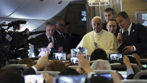Pope Francis meets reporters during his flight to Santiago, Chile, on Jan. 15, 2018. (Alessandra Tarantino / AP)