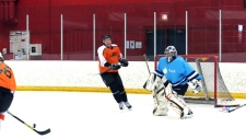 Goalie Ian Thies is shown playing for a team that selected him through Puck App.