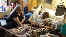Jean Jones visits with her brother, Alan Johnson, at St. Paul's Hospital in Vancouver.