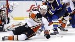 Anaheim Ducks' Logan Shaw, left, falls as he chases after a loose puck in St. Louis, on March 10, 2017. (Jeff Roberson / AP)