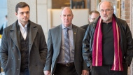 Train driver Thomas Harding, centre, leaves the courtroom with his lawyers Tom Walsh, right, and Charles Shearson, left, after a question from the jury on the fifth day of deliberations, Monday, Jan. 15, 2018 in Sherbrooke, Que. (Ryan Remiorz / THE CANADIAN PRESS)