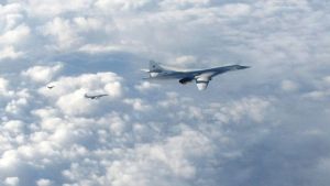 In this image made available by the Royal Air Force Monday, Jan. 15, 2018, two Russian Blackjack Tupolev Tu-160 long-range bombers are followed by an RAF Typhoon aircraft, left, scrambled from RAF Lossiemouth, Scotland. (Royal Air Force via AP)