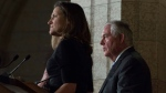 Foreign Affairs Minister Chrystia Freeland listens as U.S. Secretary of State Rex Tillerson responds to questions during a joint media availability on Parliament Hill in Ottawa, Tuesday December 19, 2017. THE CANADIAN PRESS/Adrian Wyld