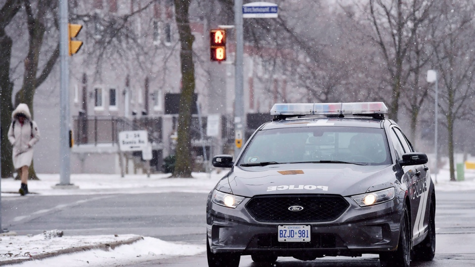 A police car passes through an intersection near Pauline Johnson Junior Public School in Toronto on Monday, January 15, 2018. A Toronto police investigation has concluded that an incident reported by an 11-year-old girl who claimed her hijab was cut by a scissors-wielding man as she walked to school did not happen. THE CANADIAN PRESS/Frank Gunn
