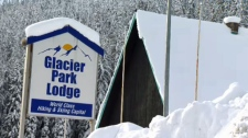 The sign outside the Glacier Park Lodge remains in place outside the hotel in Rogers Pass that closed in 2012. The building is scheduled to be demolished in the summer of 2018.