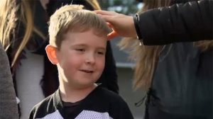 Six-year-old Landen Alexa attended a rally outside of B.C. Premier John Horgan's MLA office in Langford on Monday. Supporters held signs and called for the government to fund a life-changing drug for the boy's rare form of arthritis. Jan. 15 ,2018. (CTV Vancouver Island)