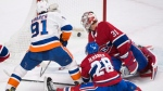 New York Islanders centre John Tavares (91) scores against Montreal Canadiens goaltender Carey Price (31) as defenceman Jakub Jerabek (28) defends during the overtime period NHL hockey action in Montreal, Monday, January 15, 2018. THE CANADIAN PRESS/Graham Hughes
