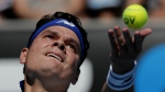 Canada's Milos Raonic serves to Slovakia's Lukas Lacko during their first round match at the Australian Open tennis championships in Melbourne, Australia on Tuesday, Jan. 16, 2018. (AP Photo/Vincent Thian)