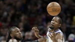 Cleveland Cavaliers' Jae Crowder, left, knocks the ball loose from Golden State Warriors' Kevin Durant in the first half of an NBA basketball game in Cleveland on Monday, Jan. 15, 2018. (AP Photo/Tony Dejak)