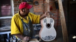 Mexican luthier Salvador Meza, makes a replica guitar from 'Coco' the movie at his workshop, in Paracho, Michoacan state, Mexico. (© Ronaldo SCHEMIDT / AFP)