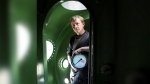In this April 30, 2008 file photo, submarine owner Peter Madsen stands inside the vessel. (Niels Hougaard /Ritzau via AP, File)