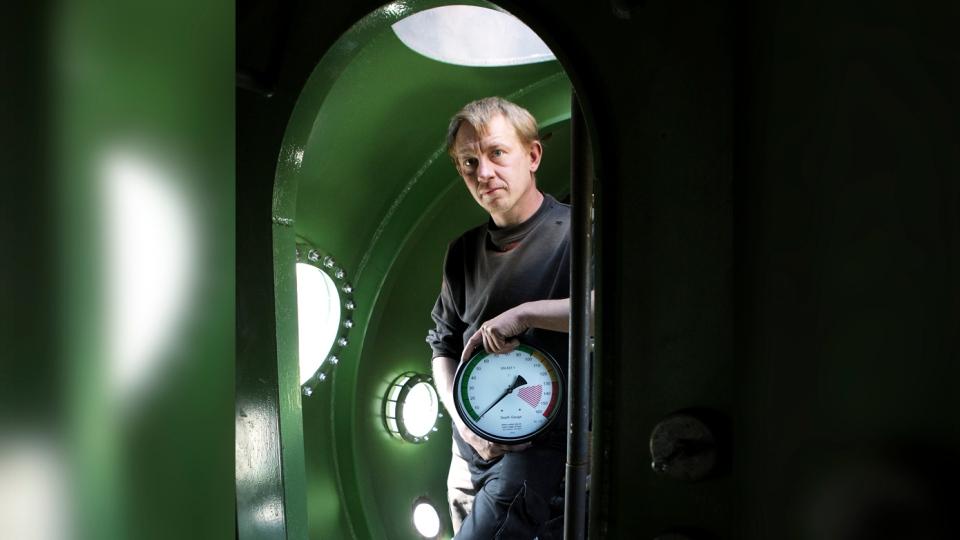 In this April 30, 2008 file photo, submarine owner Peter Madsen stands inside the vessel. (Niels Hougaard /Ritzau via AP, File)