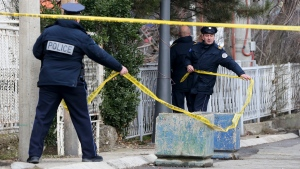 Kosovo police officers put a yellow police tape at the location where Kosovo Serb politician Oliver Ivanovic was assassinated, at the entrance of his office in the northern, Serb-dominated part of Mitrovica, Kosovo, Tuesday, Jan. 16, 2018. (AP Photo/Visar Kryeziu)