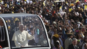 Pope Francis waves from his pope-mobile as he arrives to celebrate a Mass at O'Higgins Park in Santiago, Chile, on Jan. 16, 2018. (Alessandra Tarantino / AP)