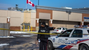 Police investigate a scene at a plaza at Keele and Lawrence in Toronto on Tuesday, Jan. 16, 2018. THE CANADIAN PRESS/Chris Donovan