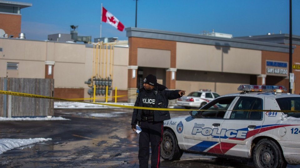Police investigate a scene at a plaza at Keele and Lawrence in Toronto after a baby was left outside a building on Tuesday, Jan. 16, 2018. THE CANADIAN PRESS/Chris Donovan