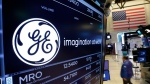 FILE - In this June 12, 2017, file photo, the General Electric logo appears above a trading post on the floor of the New York Stock Exchange. (AP Photo/Richard Drew, File)