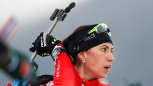 Fourth placed Rosanna Crawford of Canada prepares for shooting during the women's 12.5km mass start competition at the biathlon World Cup in Ruhpolding, Germany, Sunday, Jan. 14, 2018. (AP Photo/Matthias Schrader)