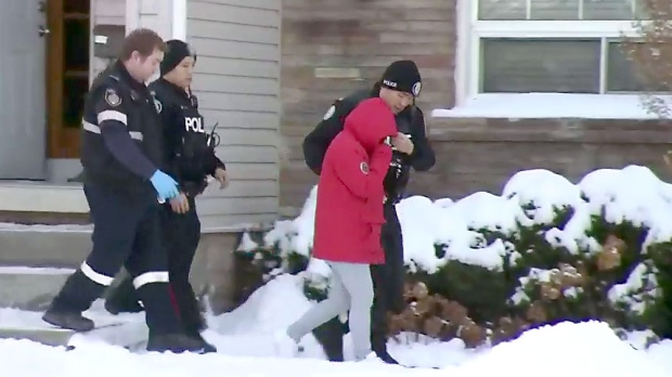The mother of a baby initially reported as abandoned is led out of a North York home on Jan. 16, 2018.
