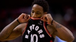 Toronto Raptors guard DeMar DeRozan (10) reacts during a time out during second half NBA basketball action against the Golden State Warriors in Toronto on Saturday January 13, 2018. (Cole Burston/THE CANADIAN PRESS)
