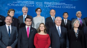 Minister of Foreign Affairs, Chrystia Freeland, centre, poses for a photo with Japan's Foreign Affairs Minister, Taro Kono, second from left, Secretary of State of the United States, Rex Tillerson, second from right, and Korea's Foreign Affairs Minister Kang Kyung-wha, right, along with other Ministers during a meeting on the Security and Stability on the Korean Peninsula in Vancouver, B.C., Tuesday, Jan. 16, 2018. THE CANADIAN PRESS/Jonathan Hayward